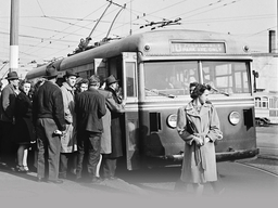 Black and white image of people boarding a street car